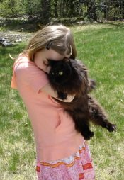 girl holding black maine coon cat